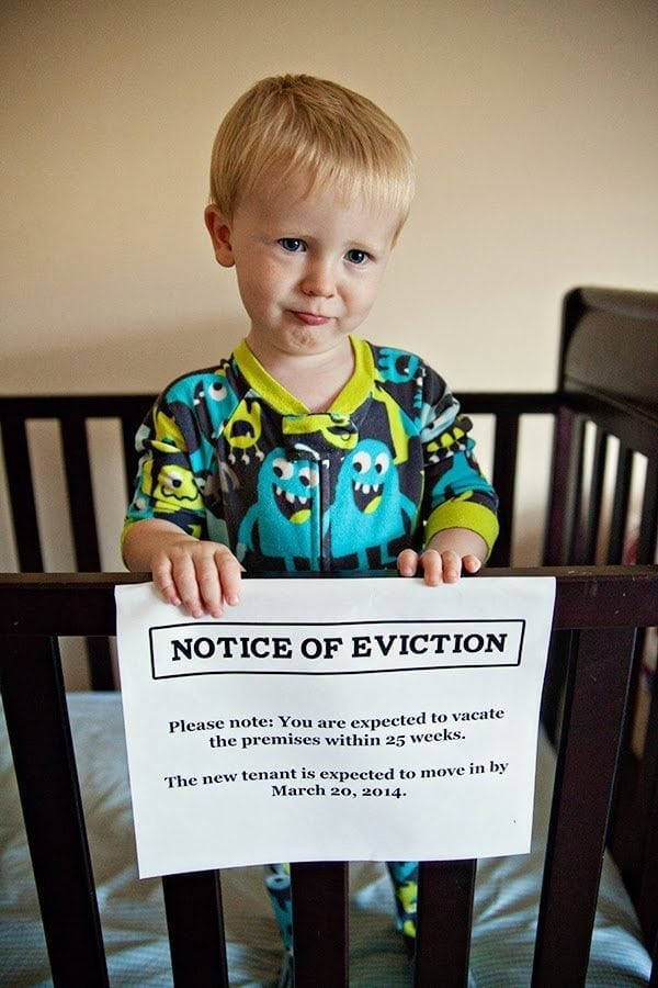 Pregnancy Announcement - Baby Eviction Notice on Side of Crib