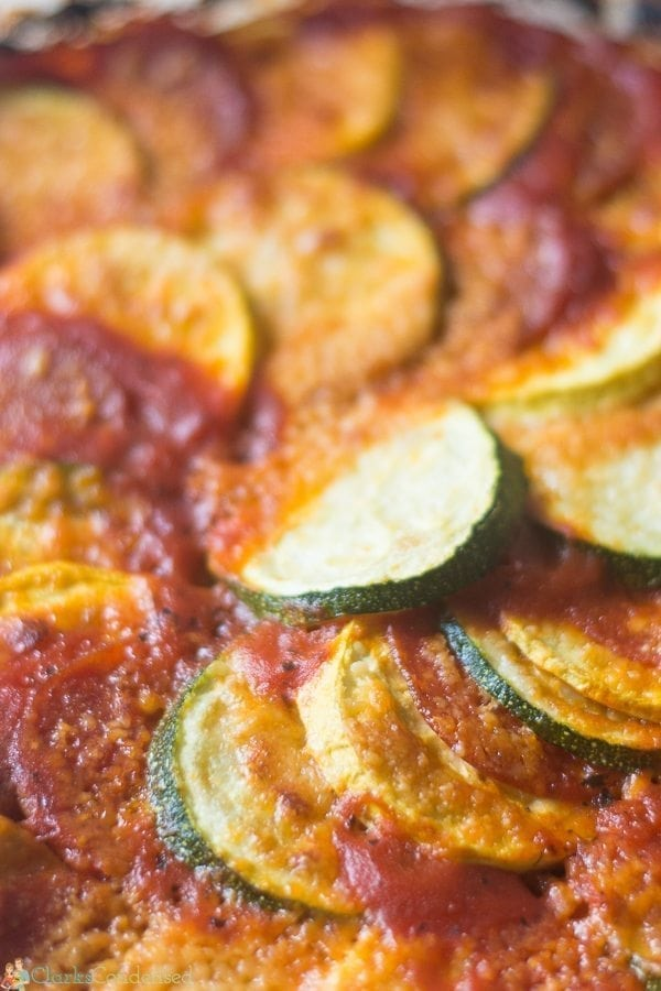 An easy squash tian recipe that is layered with zucchini, yellow squash, spaghetti sauce, parmesan cheese, and optional pepperoni! The perfect summer side dish!