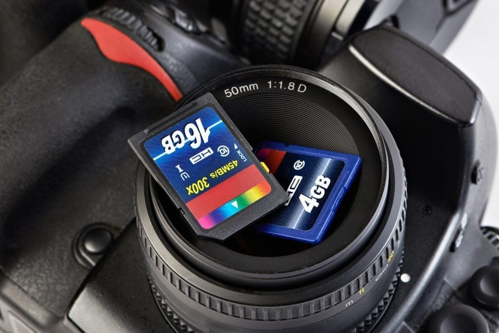 Two SD memory flash card and DSLR camera close-up