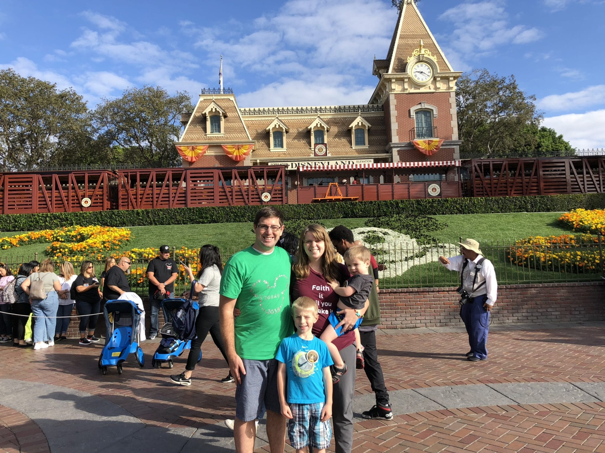 family in front of Disneyland