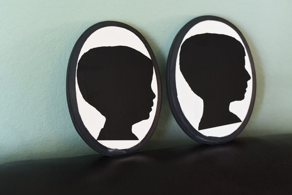 Silhouettes of two boys