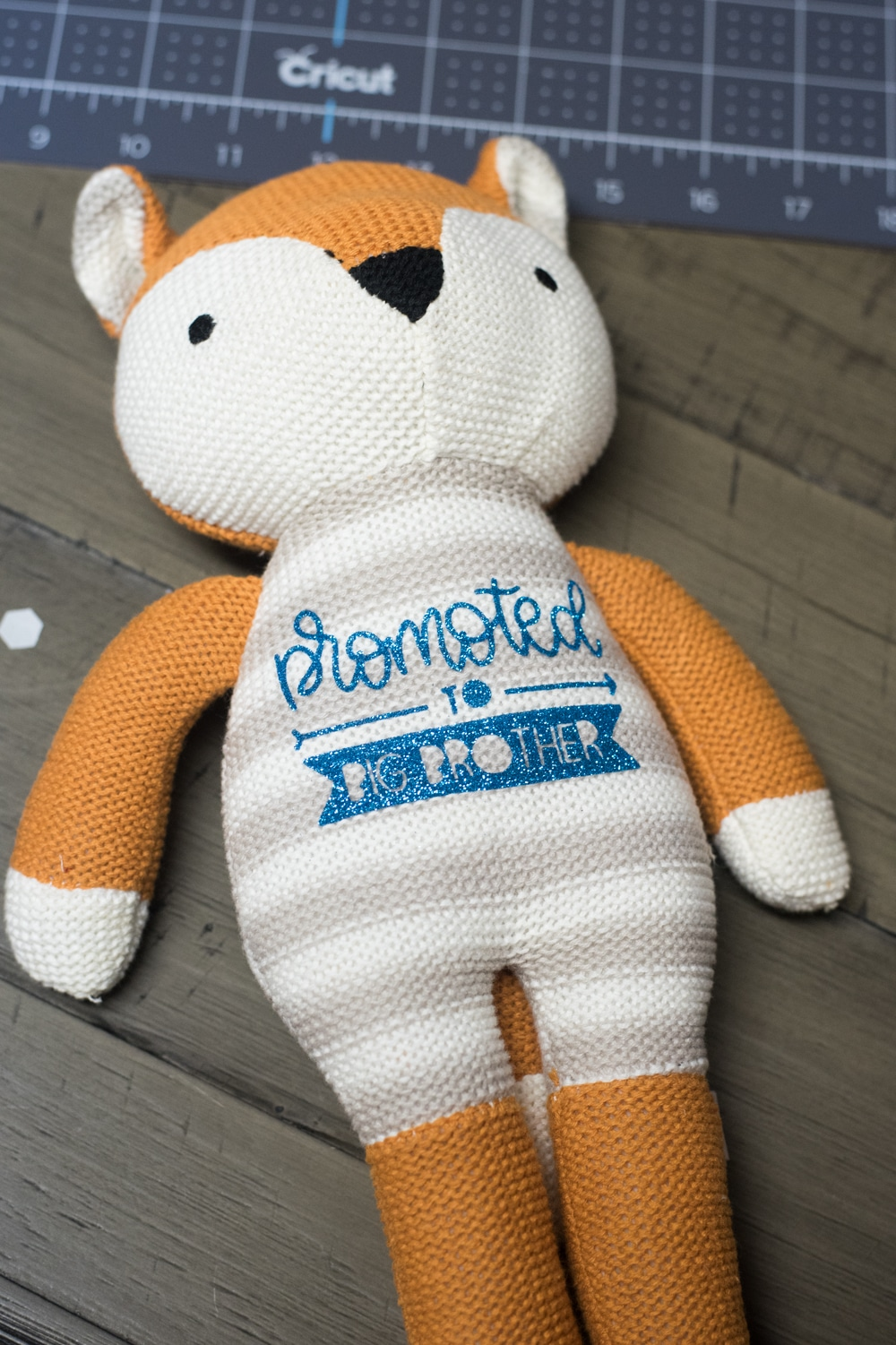 """stuffed knit fox with """"promoted to brother"""" on the front"""