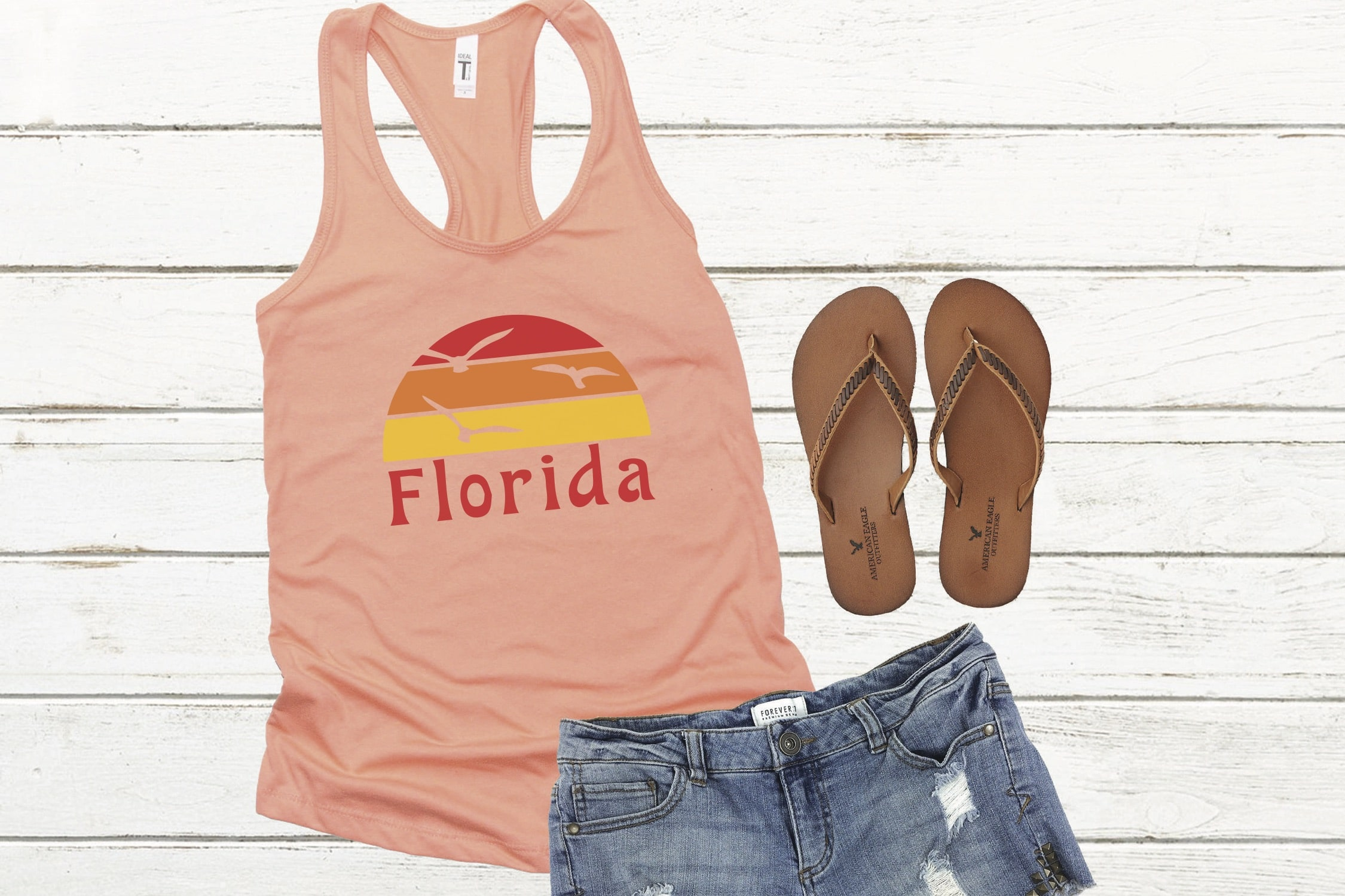 Pink tank top with Florida symbol with shorts and flip flops