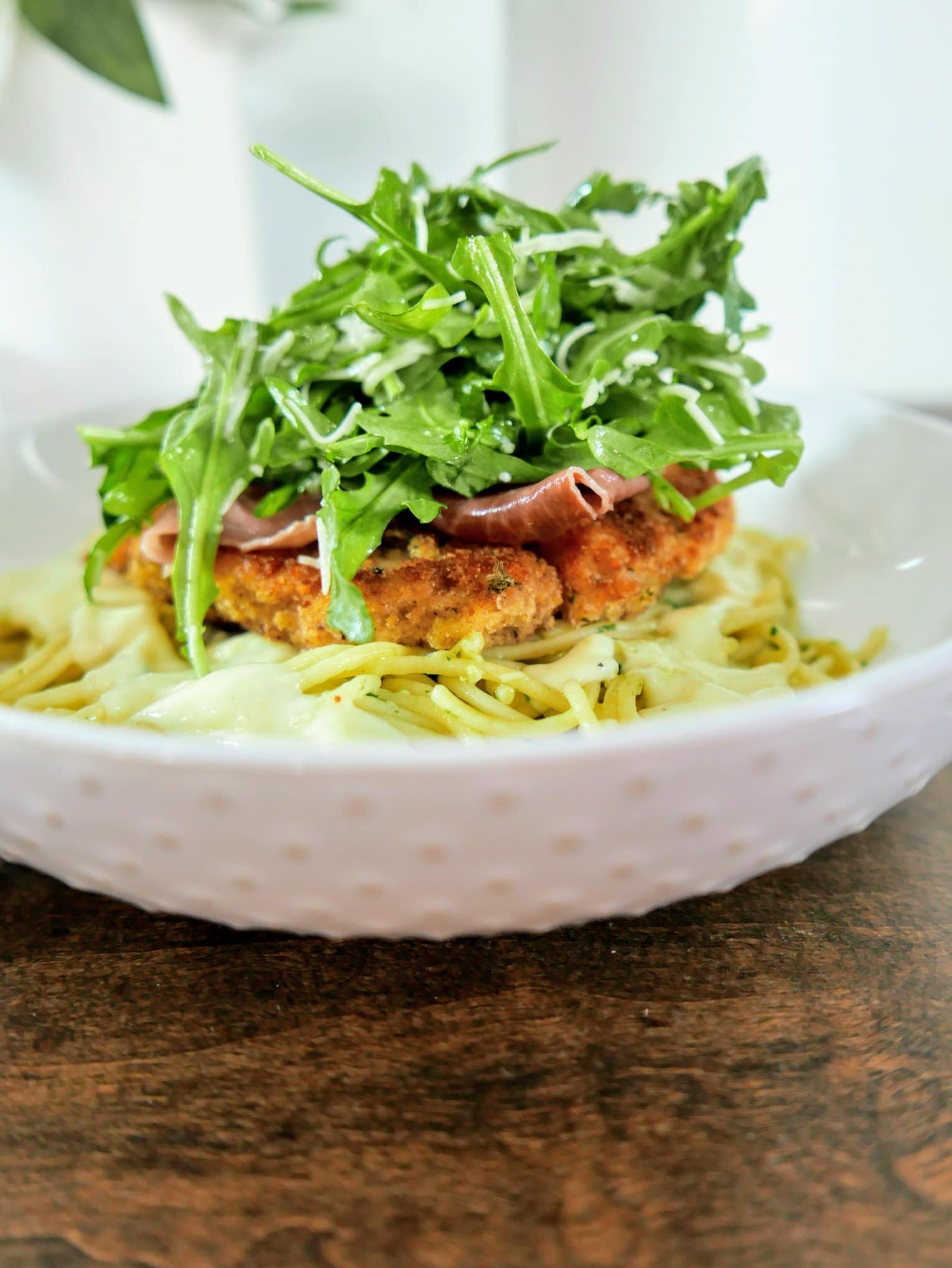arugula on top of chicken belagio