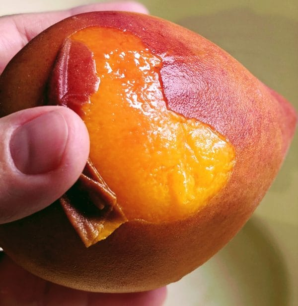 removing peel from the peach