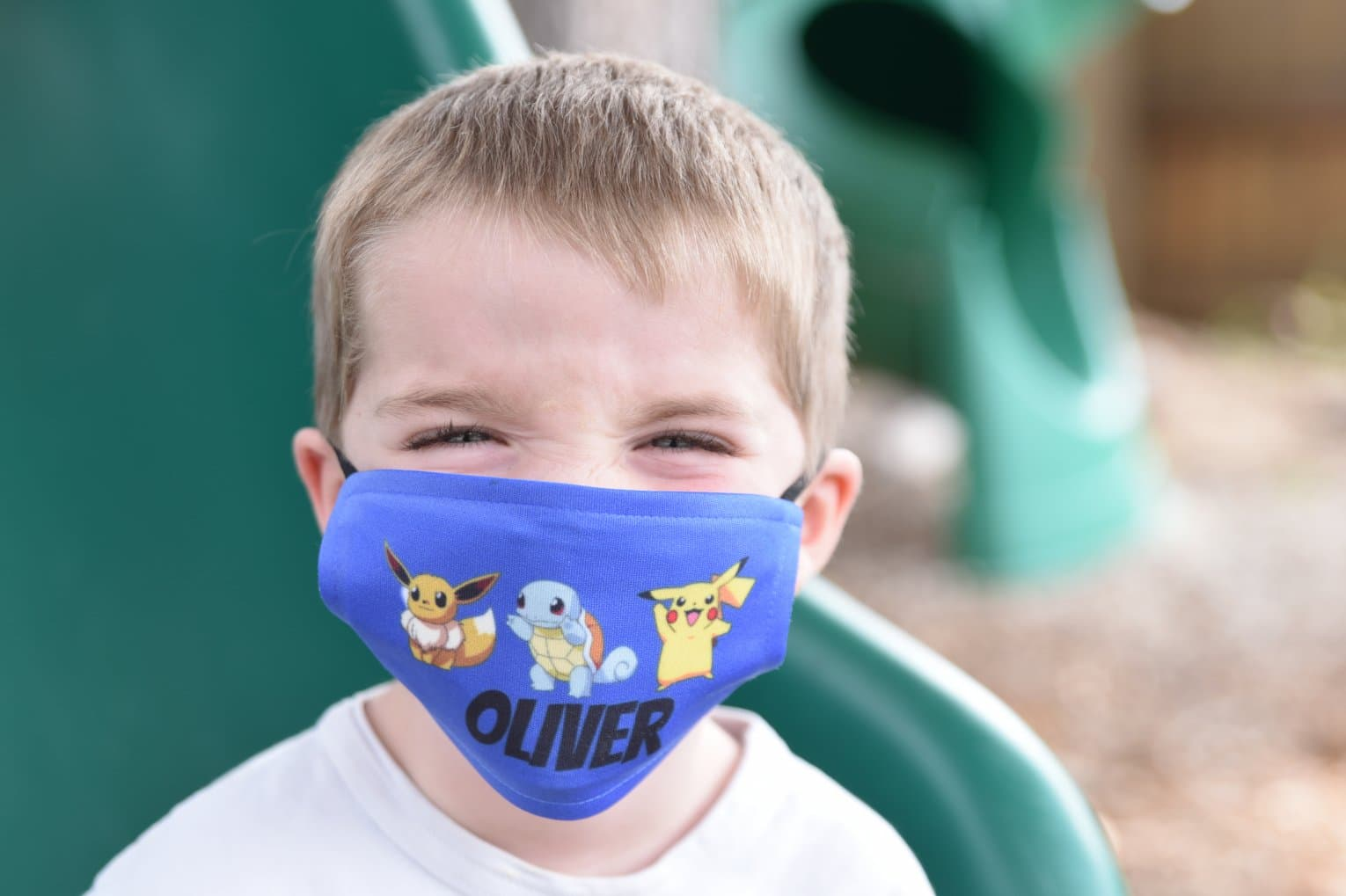 child with pokemon face mask