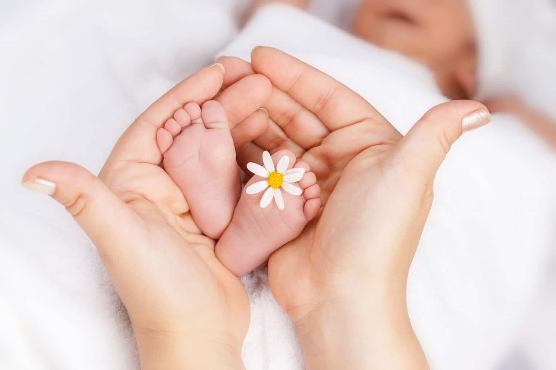 little girl feet with flower