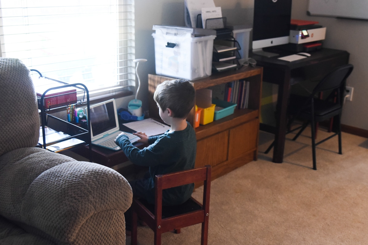 child sitting at desk