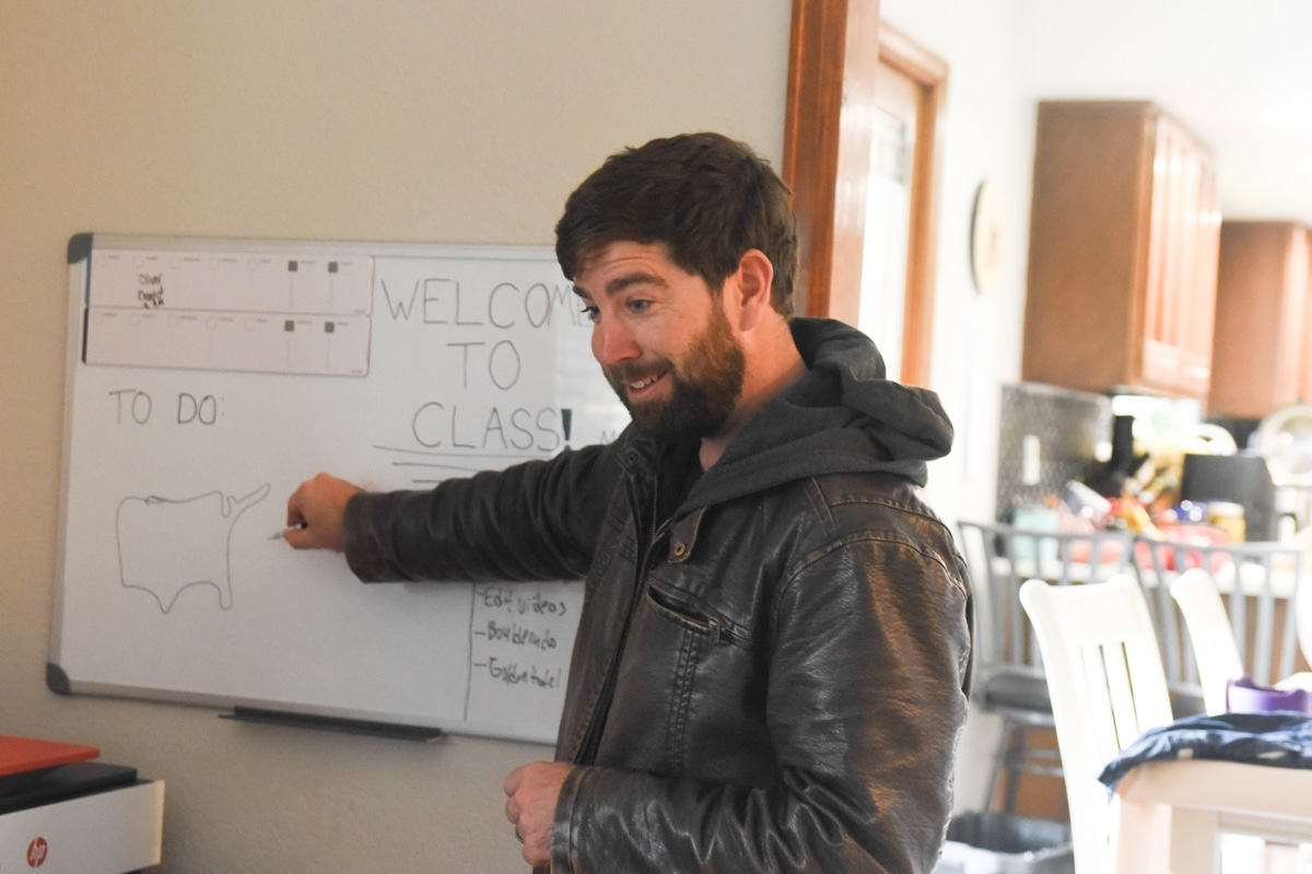 man with a white board