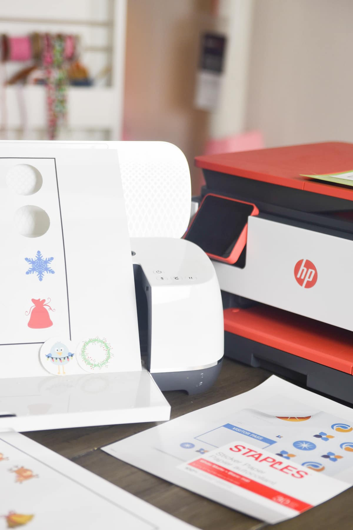 Cricut maker next to HP Printer