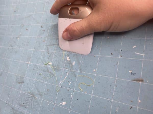 scraping material off of cricut mat